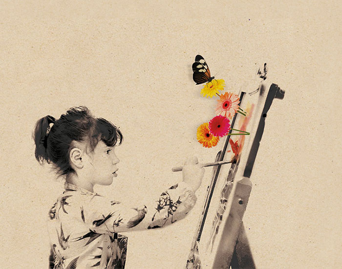 A girl painting on an upright canvas with sprouting flowers